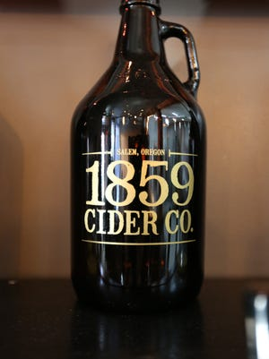 A growler from 1859 Cider Co., the first cider maker to press and ferment in downtown Salem. Photographed in 2016.