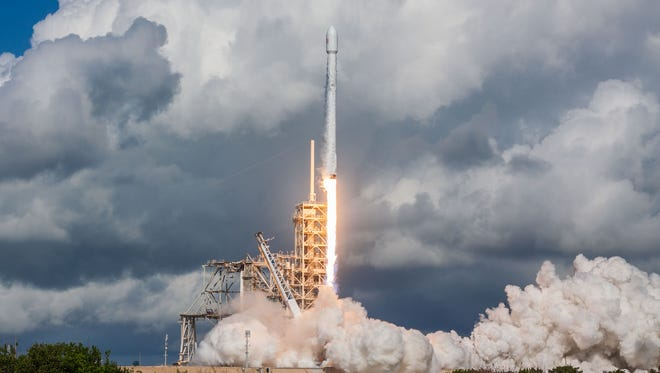 A SpaceX Falcon 9 rocket launches the Air Force's X-37B mission in September 2017. The same booster will launch the SES-12 mission in May 2018.