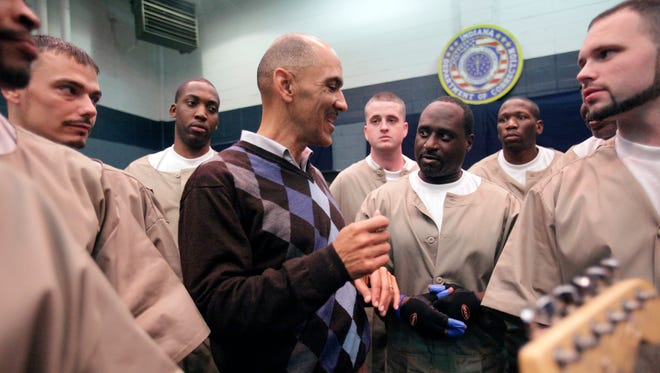 Felix Griffin (wearing gloves), 50, who plays the conga drums in the band Second Chance at Plainfield Correctional Facility, asks Tony Dungy how he can give back to the community once he is released in 6 months, Wednesday, November 17, 2010 after the Uncommon Leadership Event.  He is looking for a program to minister to youth to avoid the prison life. ****THIS IS EMBARGOED from web and print until Thursday morning.  Danese Kenon/The Star