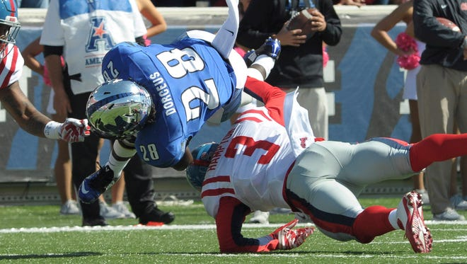 Safety C.J. Hampton (3) tackles Memphis running back Doroland Dorceus (28) during last year's game. Hampton hopes to become a bigger leader this fall for Ole Miss.