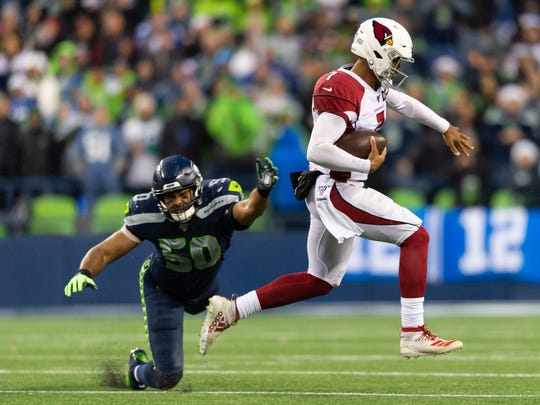 Dec 22, 2019; Seattle, Washington, USA; Arizona Cardinals quarterback Brett Hundley (7) breaks a tackle by Seattle Seahawks outside linebacker K.J. Wright (50) during the second half at CenturyLink Field. Arizona won 27-13. Mandatory Credit: Steven Bisig-USA TODAY Sports