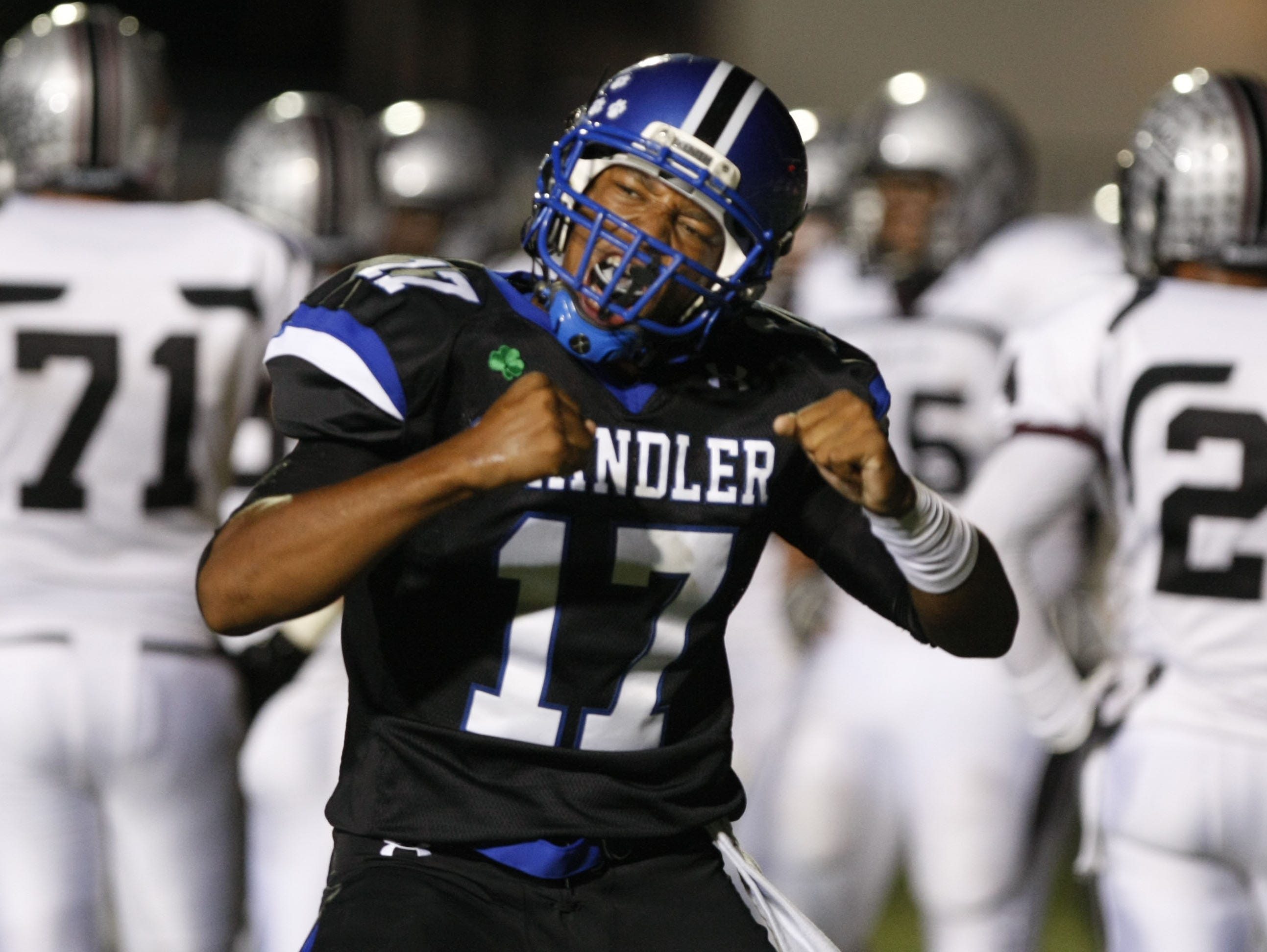 Chandler High quarterback Brett Hundley celebrates after scoring a touchdown against Hamilton High during the 2010 season.