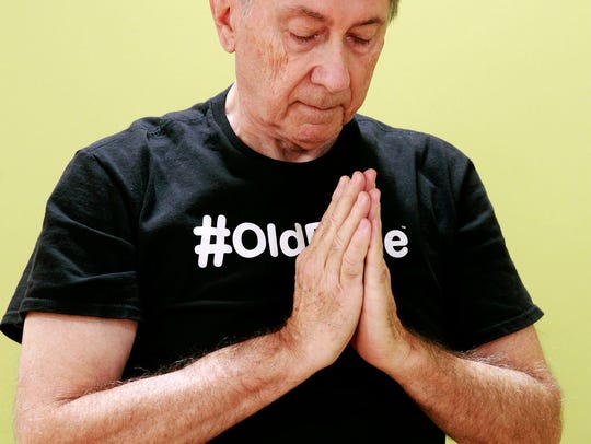 Jack Lofte demonstrates the heart center pose as part