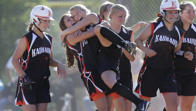 Kaukauna's Kayla VanHandel lifts Leah Layendecker following the Ghosts' 3-2 victory over Oshkosh North during their WIAA Division 1 sectional semifinal softball game Tuesday in Kaukauna.