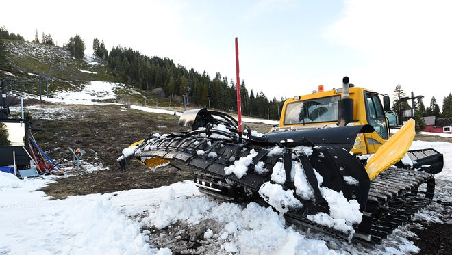 A grooming machine is seen at the base of Homewood Ski Area near Tahoe City on Feb. 10, 2015.