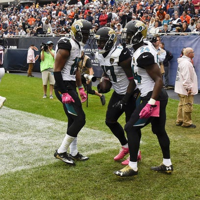 Jacksonville Jaguars wide receiver Arrelious Benn, center, celebrates his fourth quarter touchdown against the Chicago Bears with wide receiver Allen Robinson and running back T.J. Yeldon.