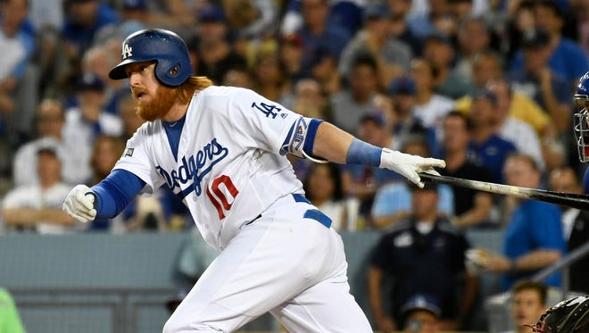 Justin Turner connects for a single in Game 5 of the NLCS.