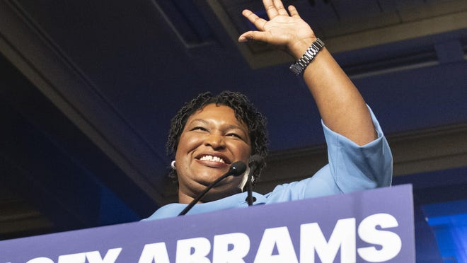 In this Nov. 6, 2018 file photo, former Georgia Democratic gubernatorial candidate Stacey Abrams speaks to supporters in Atlanta.