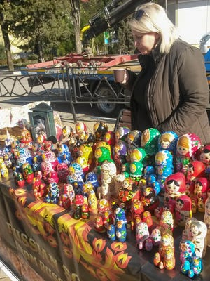 """A woman in the village of Khosta, where the Russians put the Olympic ?""""protest zone,?"""" sells matryoshka, otherwise known as stacking dolls."""