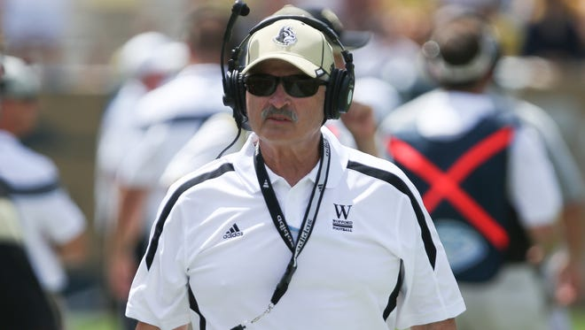 Wofford coach Mike Ayers leads his team into Oxford on Saturday.