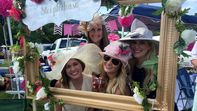 These ladies pulled out all the stops for their tailgating set-up at last year's Steeplechase, with floral decorations and a photo booth complete with their own hashtag.