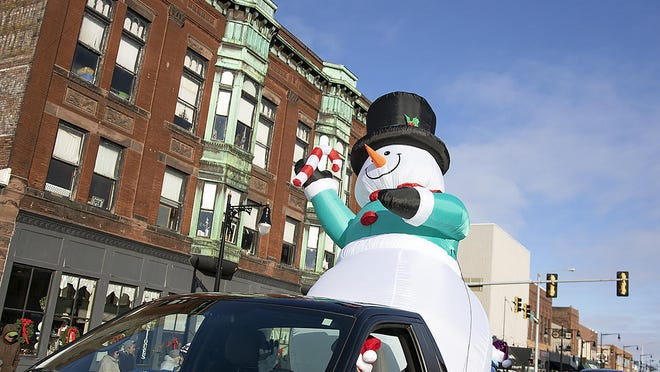 An inflatable snowman moves down Main Street during the 2018 Holiday Parade put on by the Galesburg Business Association. This year, the Galesburg Downtown Council hopes to work with the City of Galesburg to rejuvenate the city's downtown holiday lights.