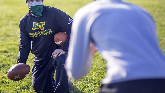 Abingdon-Avon High School football coach Rick Quinn prepares to toss the ball to a player during Tornadoes' team workouts on Monday, Oct. 5, 2020, in Abingdon.