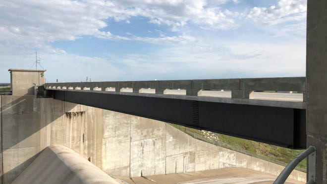 The just completed $2.2 million steel girder bridge over the spillway at Cedar Bluff Reservoir replaces an old steel truss arch bridge completed in 1950.