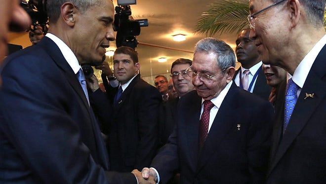 Cuban President Raul Castro and U.S. President Obama shake hands.