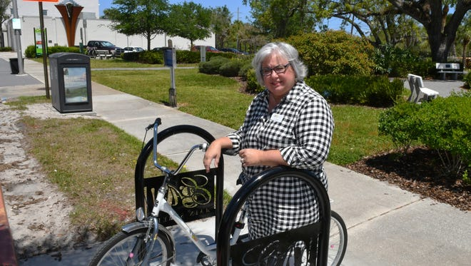 Lisa Packard, executive director of the Eau Gallie Arts District Main Street program, is a supporter of the community development agency in her Melbourne community. That CRA, among other things, helped provide bicycle racks along Highland Avenue.