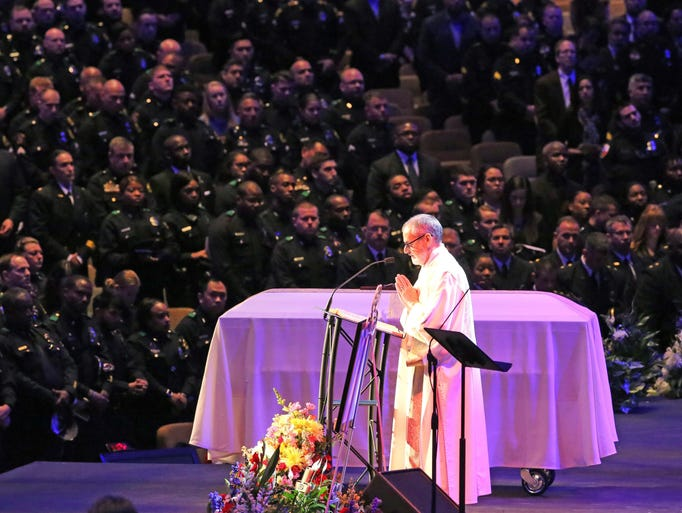Scripture is read at the funeral for Dallas police