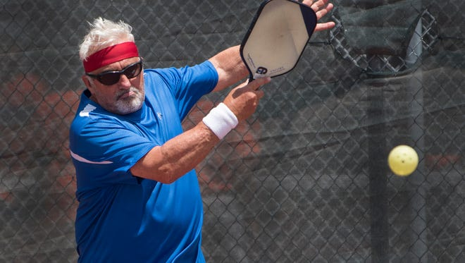 Jim Cohen hits a shot during a pickup pickleball game at media day at the US Open Pickleball Championship at East Naples Community Park April 21, 2017. Cohen will be playing in the tournament.