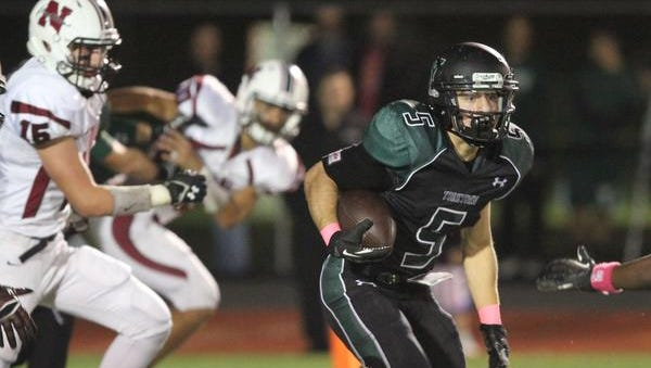 Yorktown's Nicolas Santavicca (5) runs through the Nyack  defense on a first half run during a boys football game at Yorktown School  Oct. 24, 2014. Yorktown won the game 28-21.