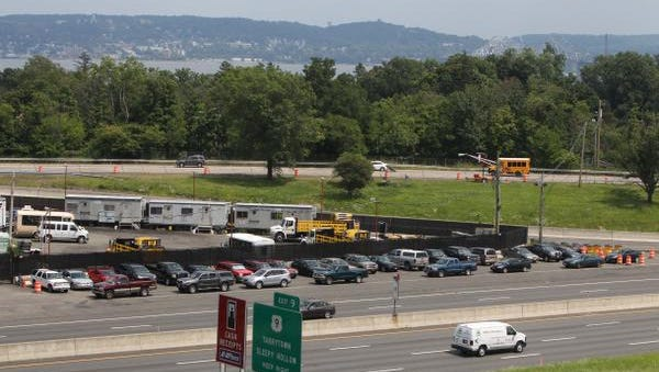Workers for the Tappan Zee Bridge construction project park their cars at interchange 10 on the New York State Thruway in South Nyack July 31, 2014.