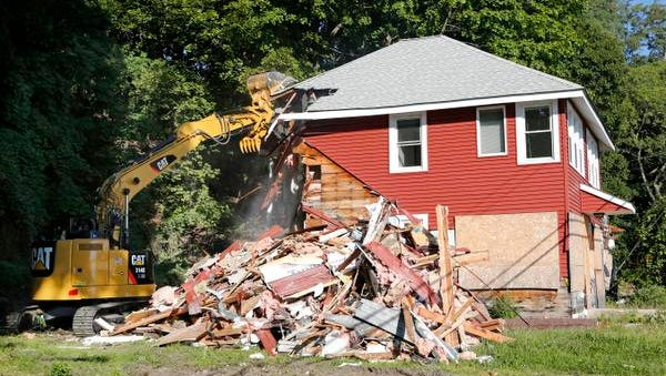 The foreclosed home at 39 Beach Road is demolished Sept. 4, 2014 in Stony Point. The town of Haverstraw has started demolishing several homes that were badly damaged by Superstorm Sandy as they become hazardous.