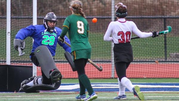 Lakeland's Alex Halpin makes a save against Garden City during the state Class B field hockey championship Sunday in Endwell. Lakeland won 3-1.