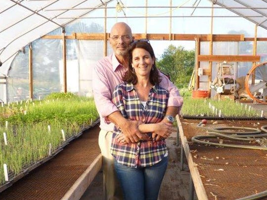 Husband and wife Paul Profeta and Joanne Malino, owners/co-founders of Profeta Farms in Readington, pose in the greenhouse.