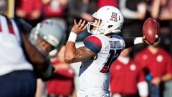 Arizona quarterback Anu Solomon throws a pass against Washington State during the first quarter of an NCAA college football game Saturday, Oct. 25, 2014, in Pullman, Wash. (AP Photo/Dean Hare)