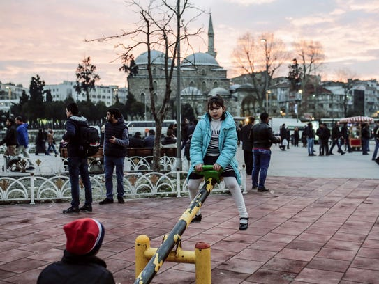 Refugee children play at Aksaray square in Istanbul.