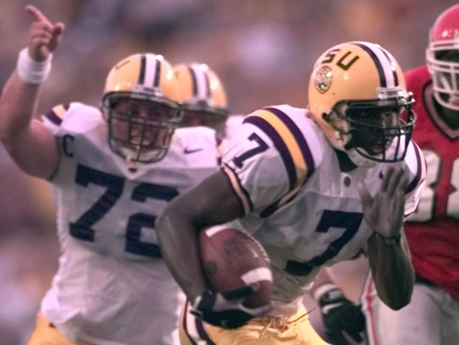 Former LSU running back Rondell Mealey races to the end zone as Tiger offensive lineman Todd McClure (72) points the way during a game in Baton Rouge in 1988. McClure is No. 25 on The Times' list of greatest Independence Bowl players of all-time.