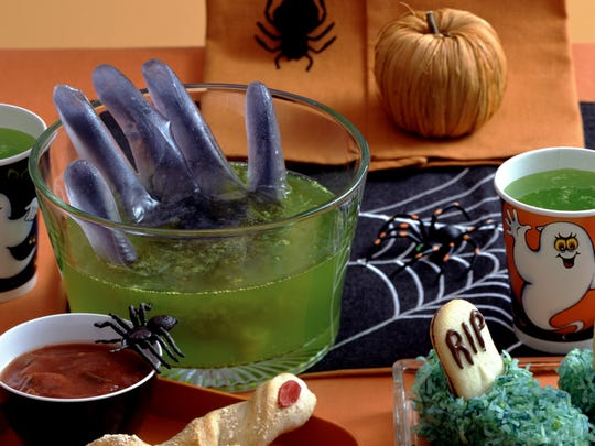 A purple hand, a clear sterile glove filled with frozen purple water, rises from a lemon lime punch that's bilious green.