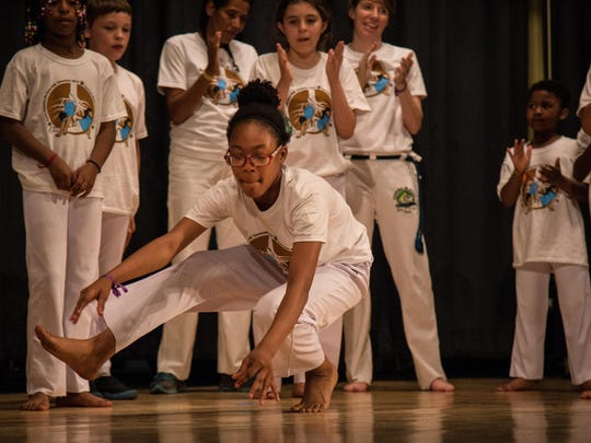 The moves and sounds of Brazil filled the auditorium at Moulton Elementary School on May 13 as students took part in a year-end celebration of a unique after-school program at their school. The students have been taking part in a program to learn Capoeira, a Brazilian form of martial arts that incorporates dance, acrobatics and music.