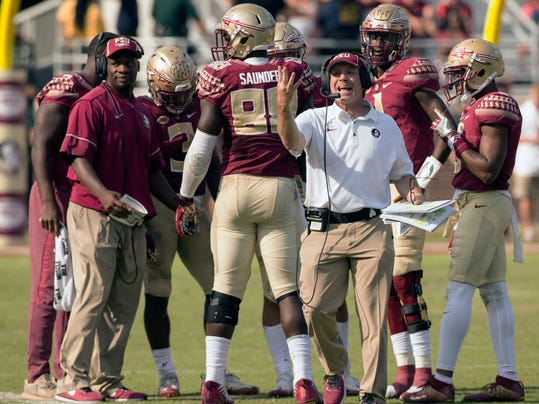 Florida State head coach Jimbo Fisher comes out of the huddle looking for the referee in the second half of an NCAA college football game against Syracuse in Tallahbadee, Fla., Saturday, Nov. 4, 2017. Florida State defeated Syracuse 27-24. (AP Photo/Mark Wallheiser) (AP Photo/Mark Wallheiser)