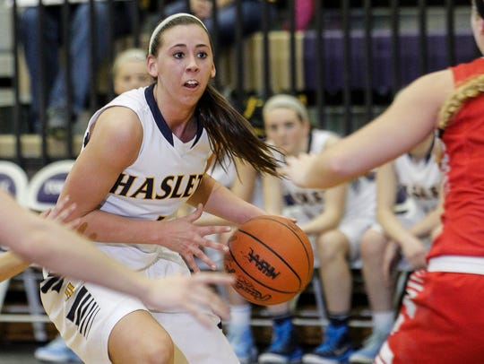 Haslett's Makenna Ott drives against Perry March 4,