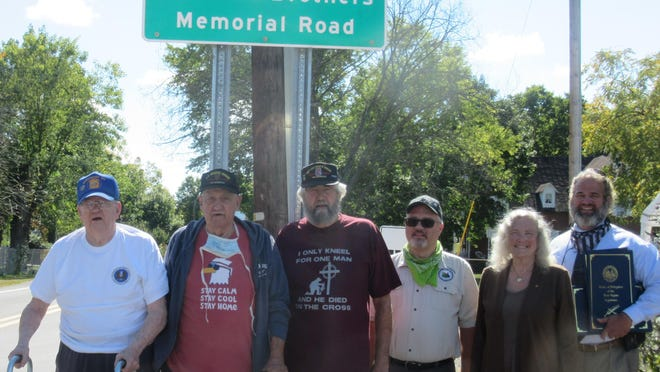 Upper Patterson Creek Road to Shirley Lane  Road is now named to honor the Caldwell Brothers. Shown during the dedication are l-r: John Caldwell, William Caldwell, Tom Caldwell and Delegates Gary Howell, Ruth Rowan and John Paul Hott. Tribune photo by Ronda Wertman
