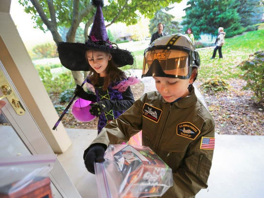Abby Kelley, 9, and her brother, Nick, 7, go trick