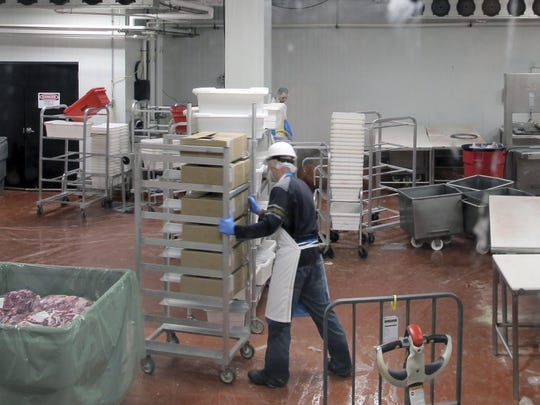 Employees work at Vermont Packinghouse, a slaughterhouse