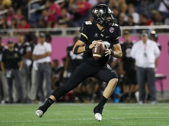 Dec 17, 2016; Orlando , FL, USA; UCF Knights quarterback McKenzie Milton (10) drops back to pass in the second quarter against the Arkansas State Red Wolves at Citrus Bowl Stadium. Mandatory Credit: Logan Bowles-USA TODAY Sports