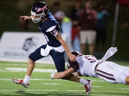 South-Doyle quarterback AJ Nunn is sacked by Bearden's Nate Adkins on Thursday, September 7, 2017.
