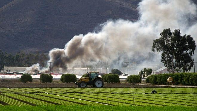 Smoke billows above the scene of an explosion near Mission Rock Road in Santa Paula in November 2014.