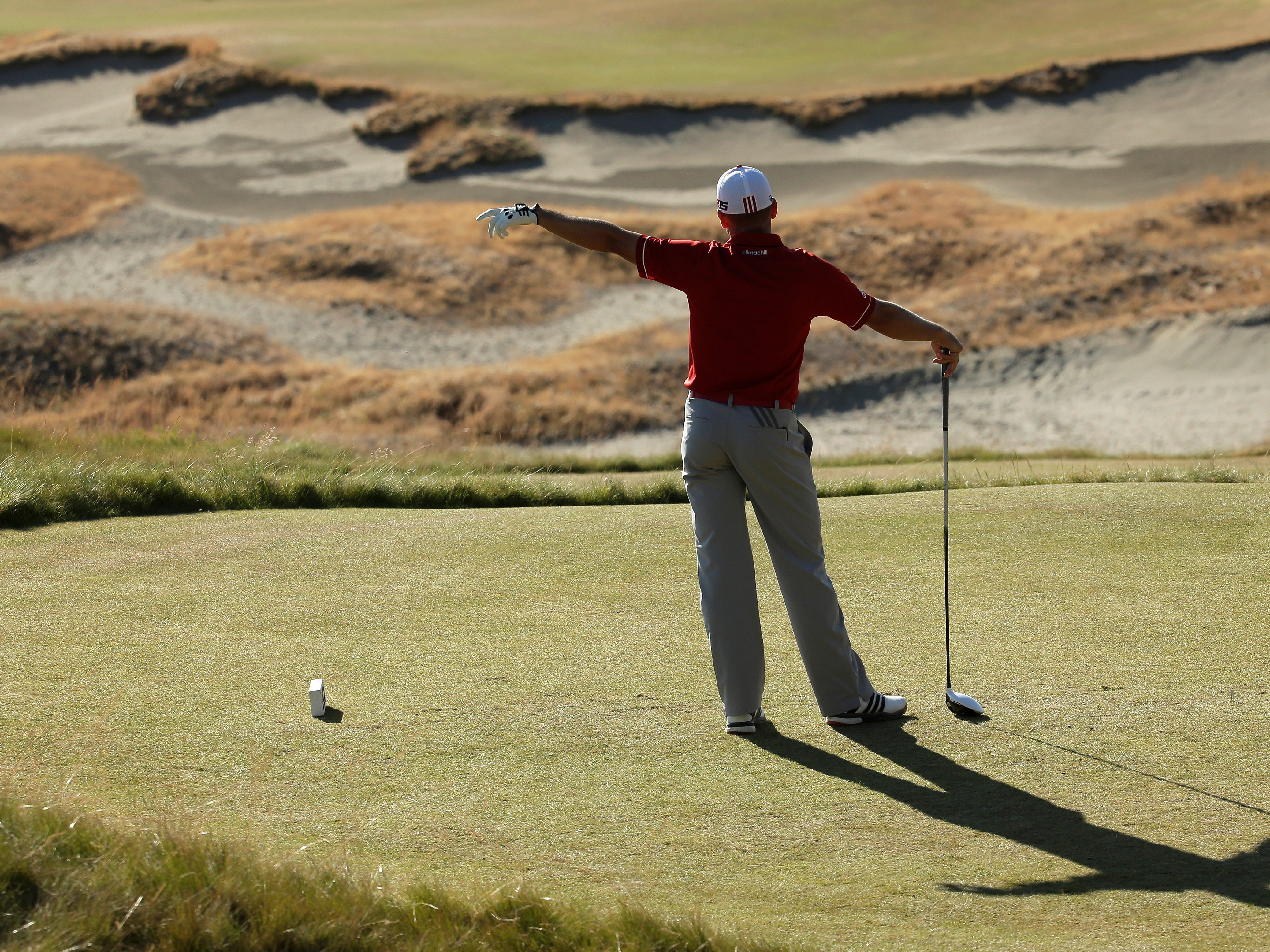 Sergio Garcia, of Spain, watches his tee shot on the 14th hole during the second round of the U.S. Open golf tournament at Chambers Bay on Friday, June 19, 2015 in University Place, Wash. (AP Photo/Charlie Riedel)