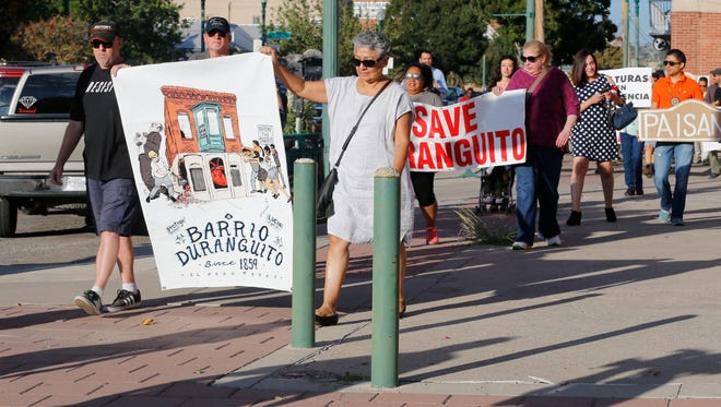 Duranguito protesters march to City Hall in September to protest any potential demolition of buildings in the old neighborhood.