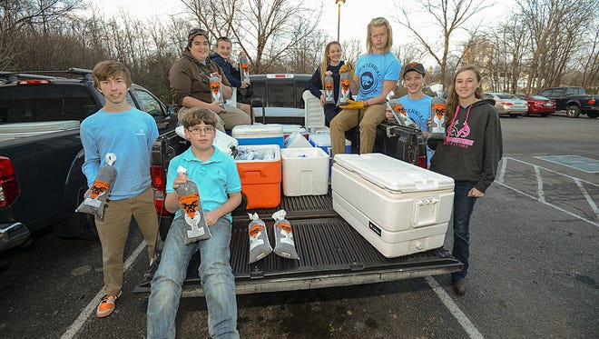 Students from Centennial High's Hunger Challenge Club pose with five-pound bags of local deer meat.