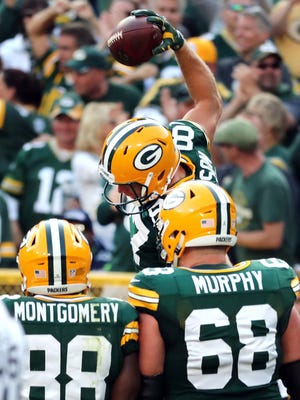 Packers wide receiver Jordy Nelson slams the ball on the field instead of a Lambeau Leap after his touchdown.