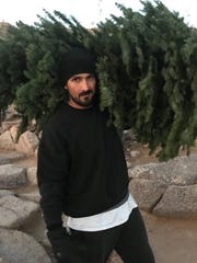 Beau Goff carried the new Christmas tree up Camelback Mountain even though he had climbed it once already the same morning.
