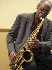 Saxophonist Maurice Johnson plays a solo Thursday during