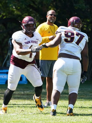 Arizona State assistant coach Michael Slater works with defensive linemen (1) JoJo Wicker and (97) Shannon Foster at Camp Tontozona on Wednesday, Aug. 2 , 2017 in Kohls Ranch, Ariz.