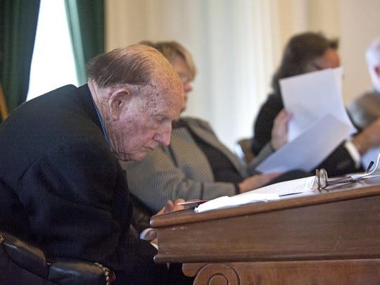 Sen. William Doyle, R-Washington, reads a bill on the opening day of the Legislature at the Statehouse in Montpelier in January 2014.