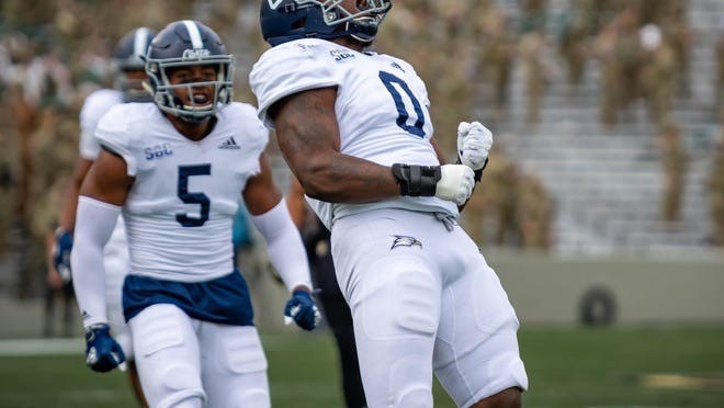 Georgia Southern senior defensive end Raymond Johnson III (0) celebrates a play with linebacker Benz Jose (5) against host Army on Satruday in West Point, N.Y.