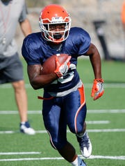 UTEP sophomore running back Walter Dawn looks for a hole in the offensive line to attack through during a recent practice as the team prepares for the upcoming game against Oklahoma on Saturday afternoon in Norman.